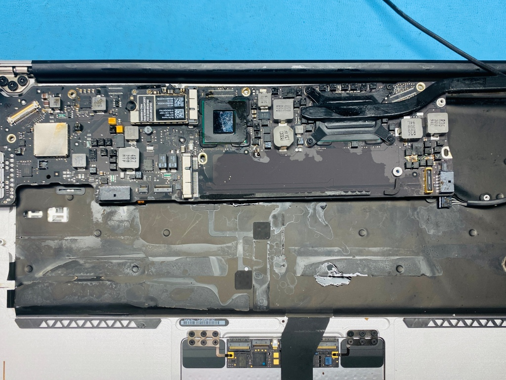 Water damage macbook air interior. Corrosion on the logic board