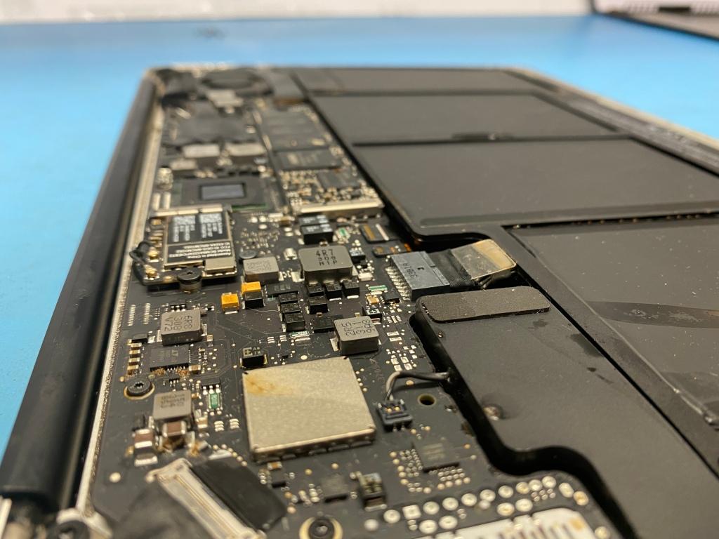 Macbook water damage repair princeton texas. Corrosion on the logic board